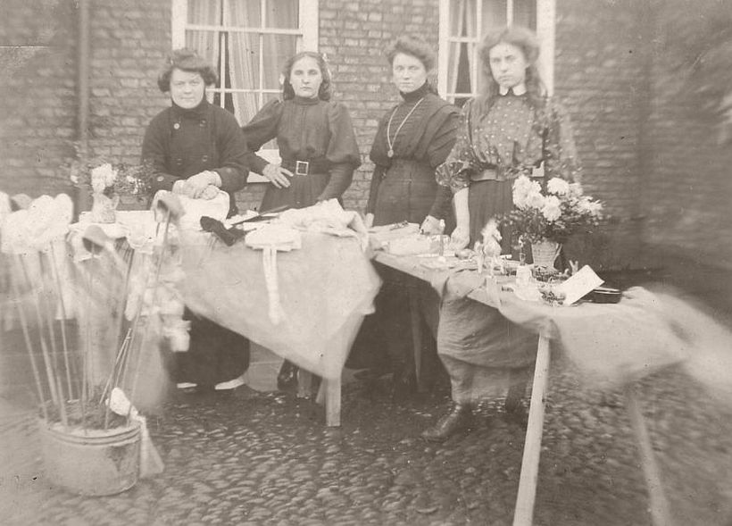 Four women tend a stall selling hand-made items