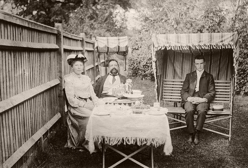 Edwardian family having tea in the garden