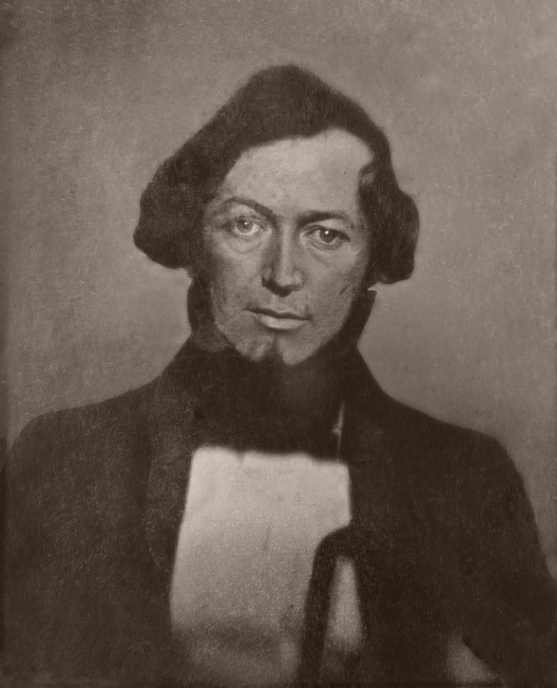 Daguerreotype photograph of Elliott Cresson by photographer Robert Cornelius, cropped, gray-scaled, tone balanced between dark and light, 1840.