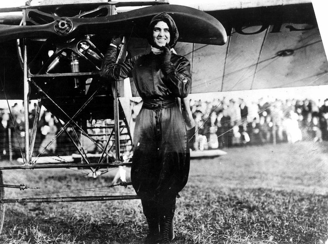 Harriet Quimby in her purple flight suit.