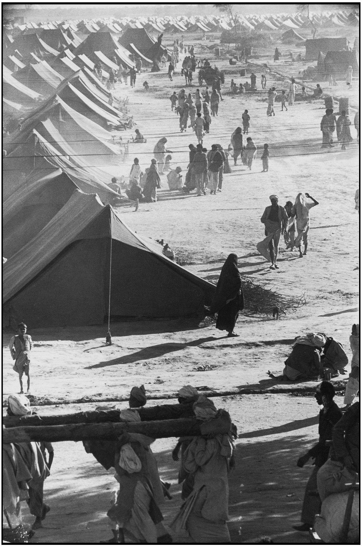 Henri Cartier-Bresson, The Decisive Moment (Simon & Schuster, 1952), p. 93, A Refugee Camp, Kurukshetra, India, 1947. © Henri Cartier-Bresson/Magnum Photos.