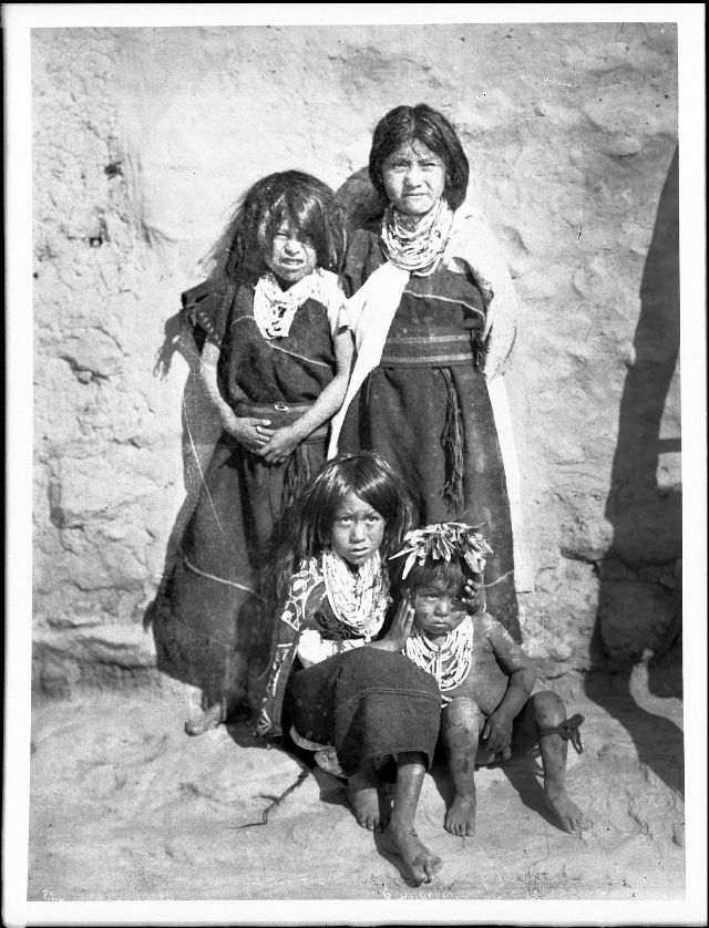 Hopi children from a well-to-do family waiting for the Snake Dance at the pueblo of Walpi, Arizona