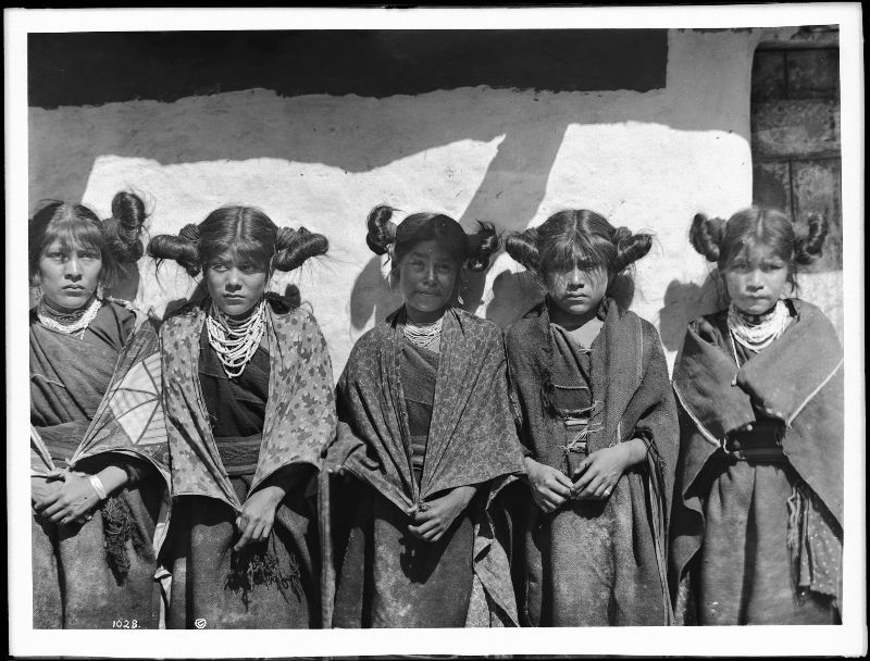Five young Hopi Indian girls standing in a row in the village of Shonguapavi
