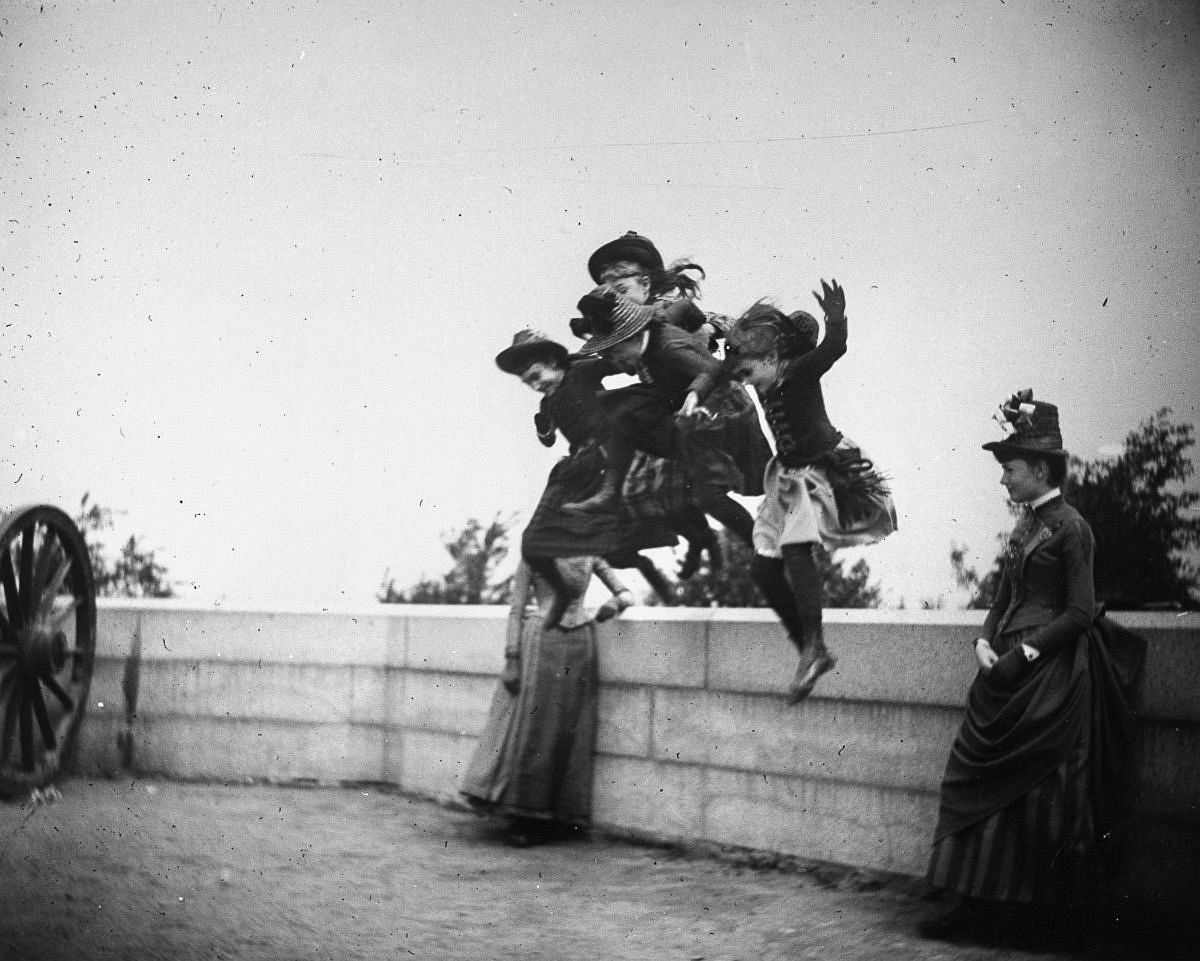 May 22, 1886 - Girls jump off a stone wall in Fort Greene.