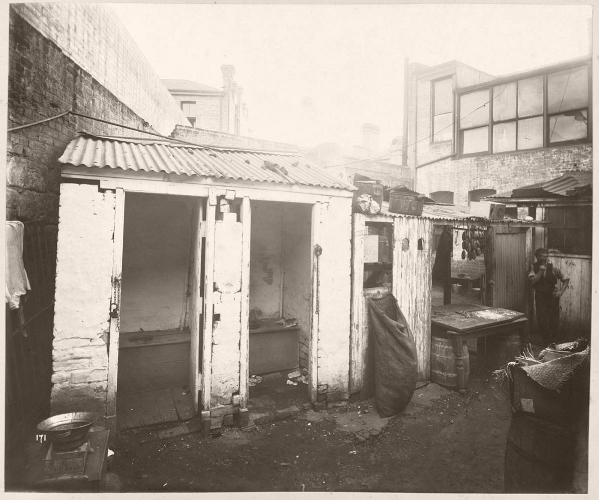 Rear of unidentified butcher's yard with adjacent outhouses