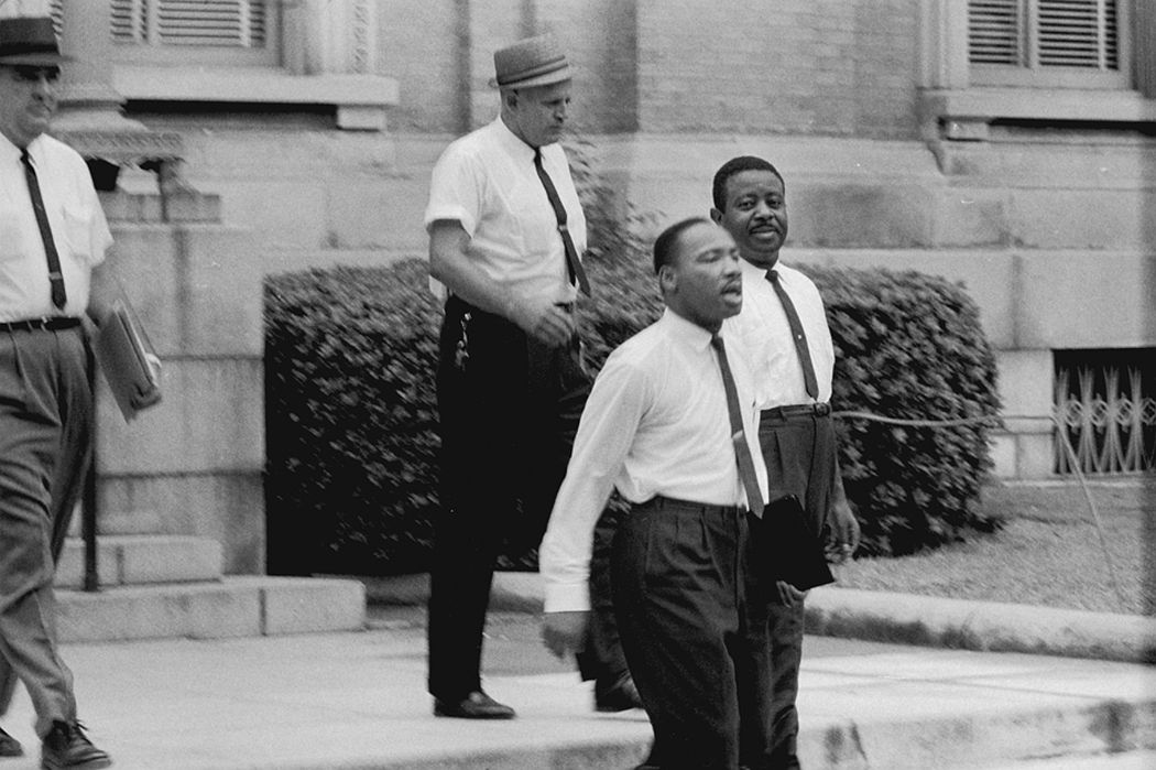 Dr. Martin Luther King, Jr. and Reverend Ralph Abernathy are escorted back to jail in Albany, Georgia, 1962. Danny Lyon (born 1942). Gelatin silver print, 11 x 14 inches. © Danny Lyon, New York & Magnum Photos, New York / Courtesy Edwynn Houk Gallery, New York.