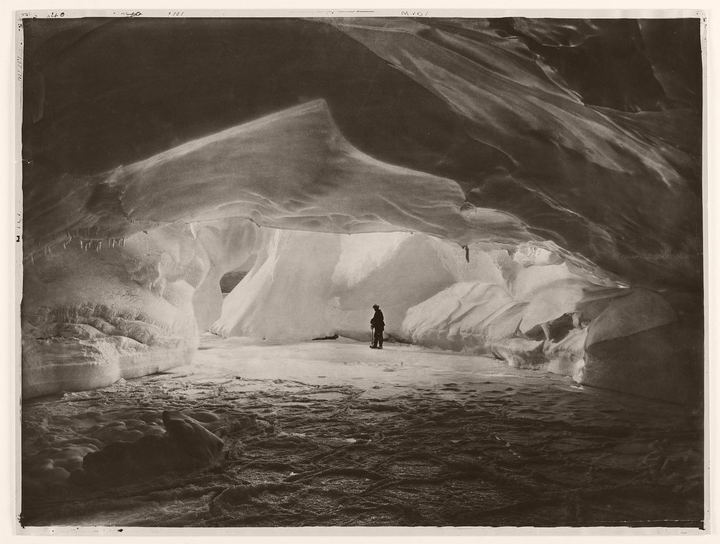 Cavern carved by the sea in an ice wall near Commonwealth Bay, circa 1912