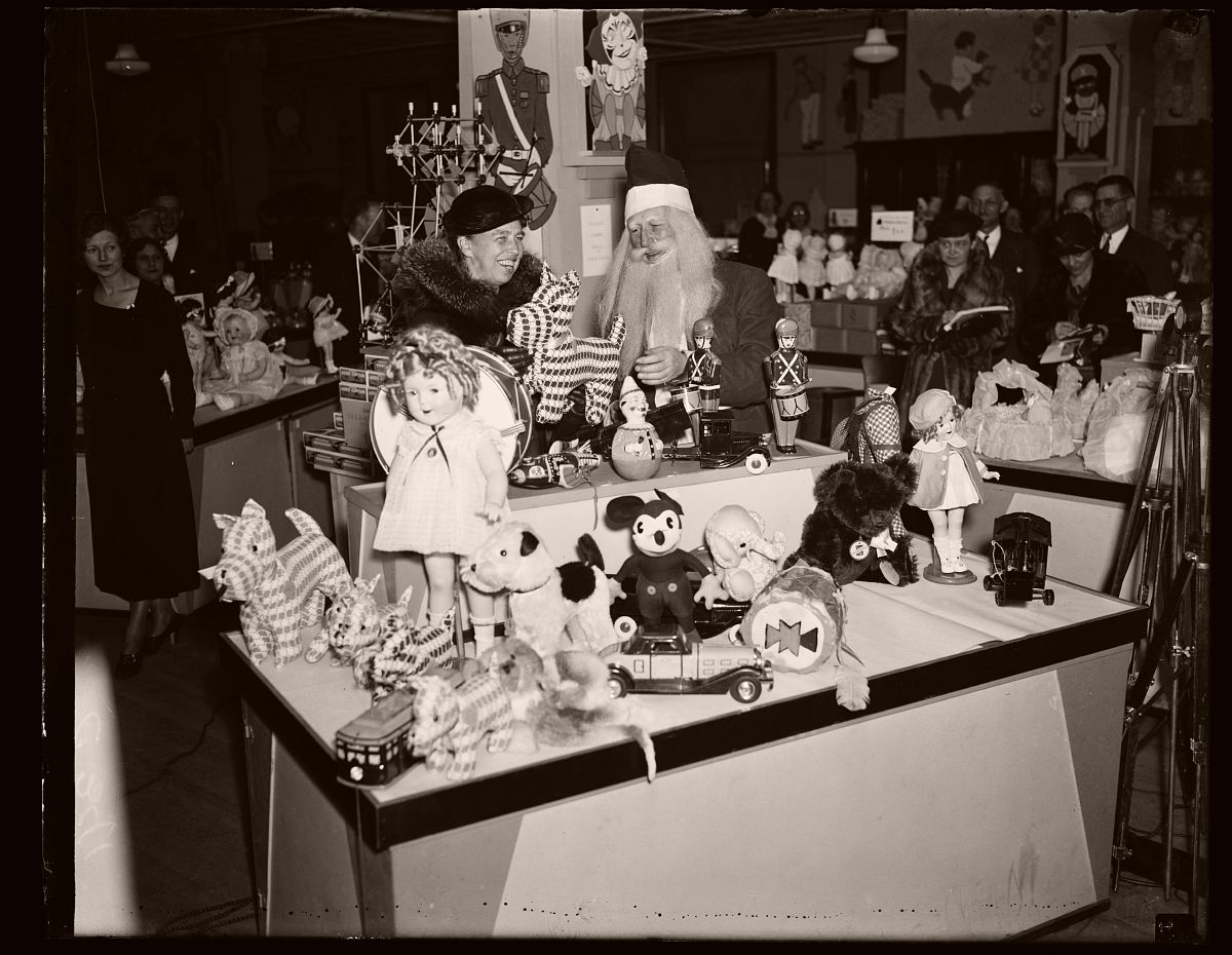 NO ELEPHANT TOYS FOR FIRST LADY. MRS. ROOSEVELT, ON A CHRISTMAS SHOPPING TOUR, HAD A HARD TIME CONVINCING SANTA CLAUS THAT SHE DID NOT WANT A TOY ELEPHANT, A SYMBOL OF THE REPUBLICAN PARTY, AS A CHRISTMAS PRESENT. SHE IS SHOWN HERE INSPECTING AN ASSORTMENT OF TOYS AT A WASHINGTON, D.C. DEPARTMENT STORE FRIDAY , 1934