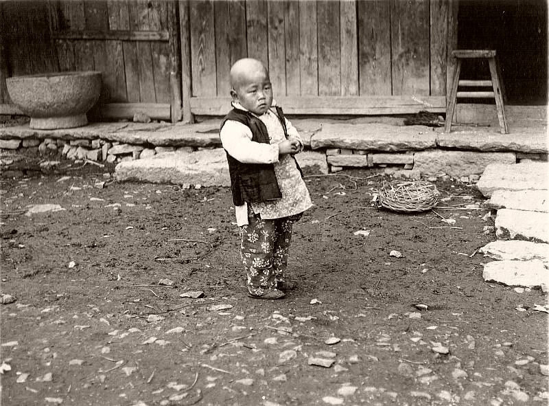 Child in front of the yard