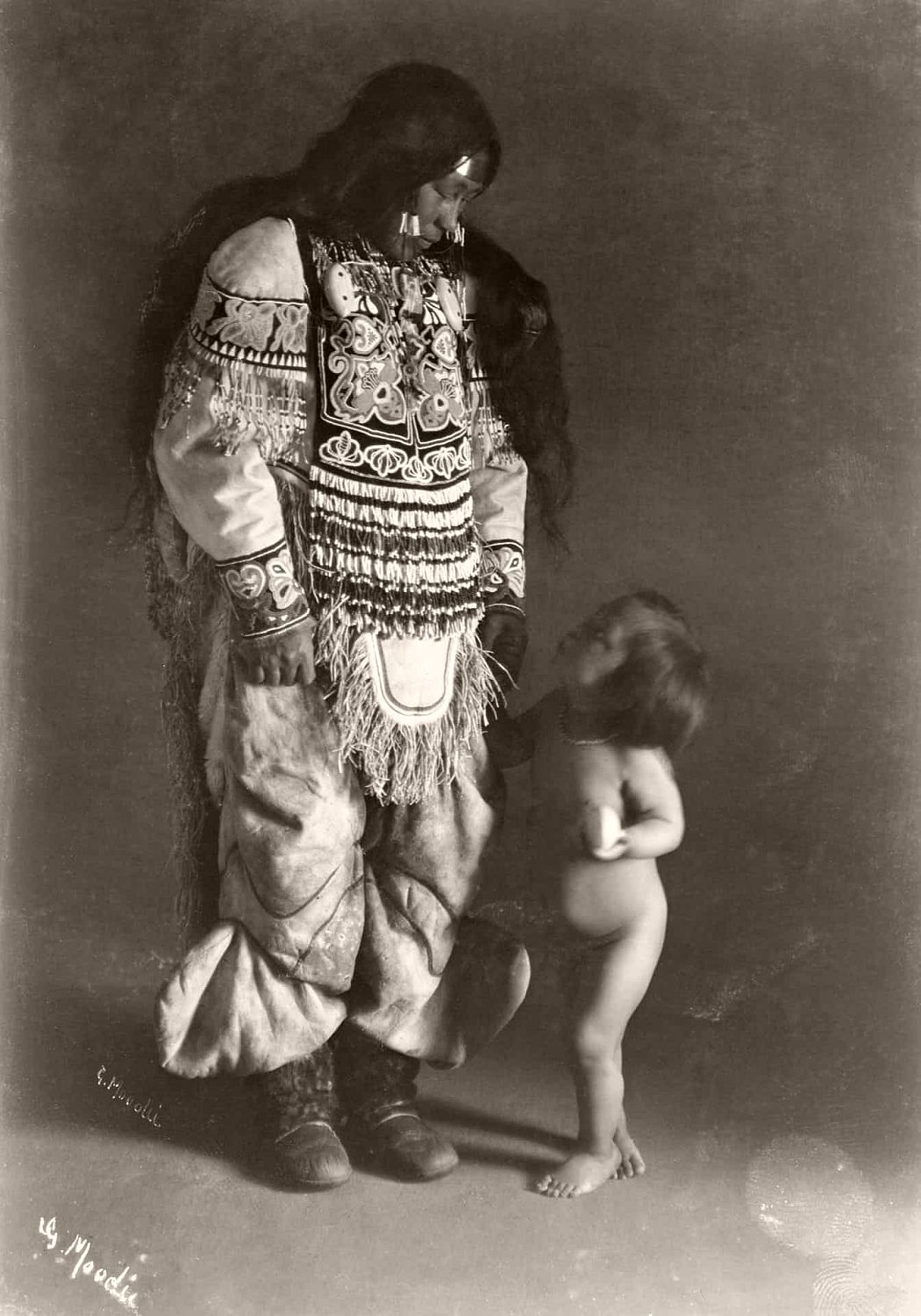 Inuit woman, Ooktook, with child, Fullerton Harbour, Nunavut, c.1904-05