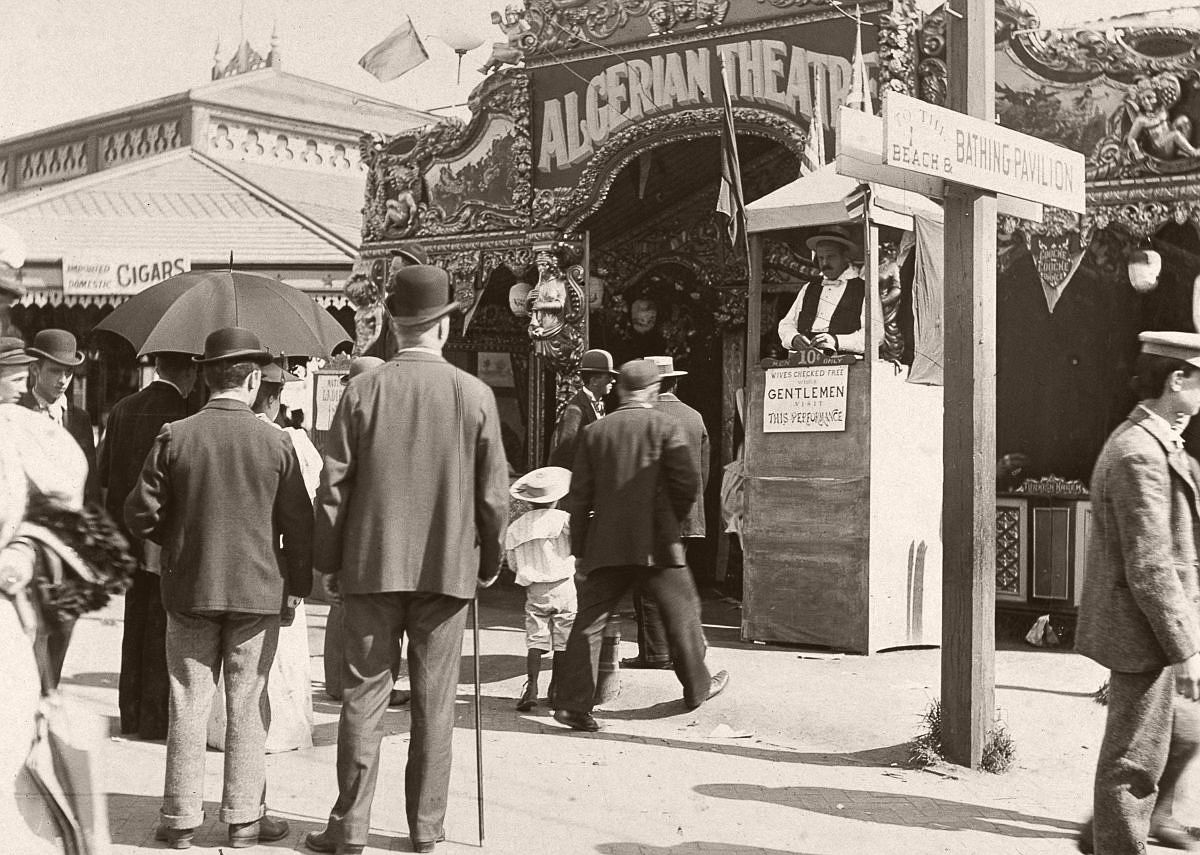 People approach the ticket booth of the Algerian Theatre on the Coney Island boardwalk, 1896.