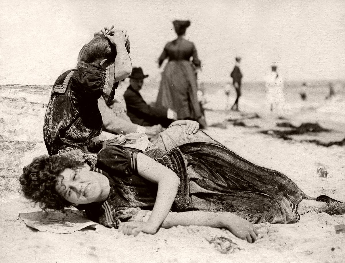 A young bather's nap is interrupted by a photographer, 1904.