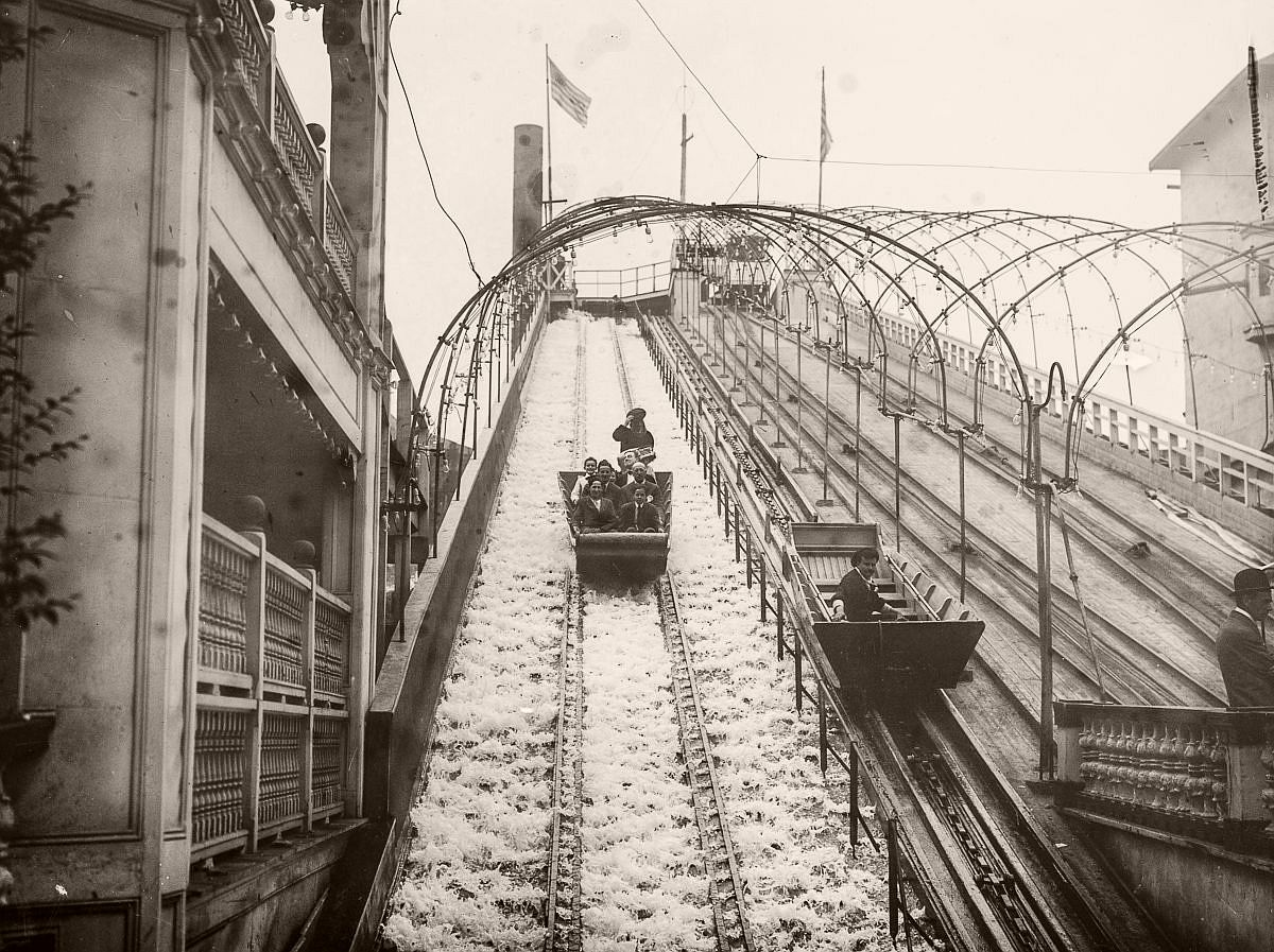 Thrillseekers ride the water chute at the amusement park, c.1900.