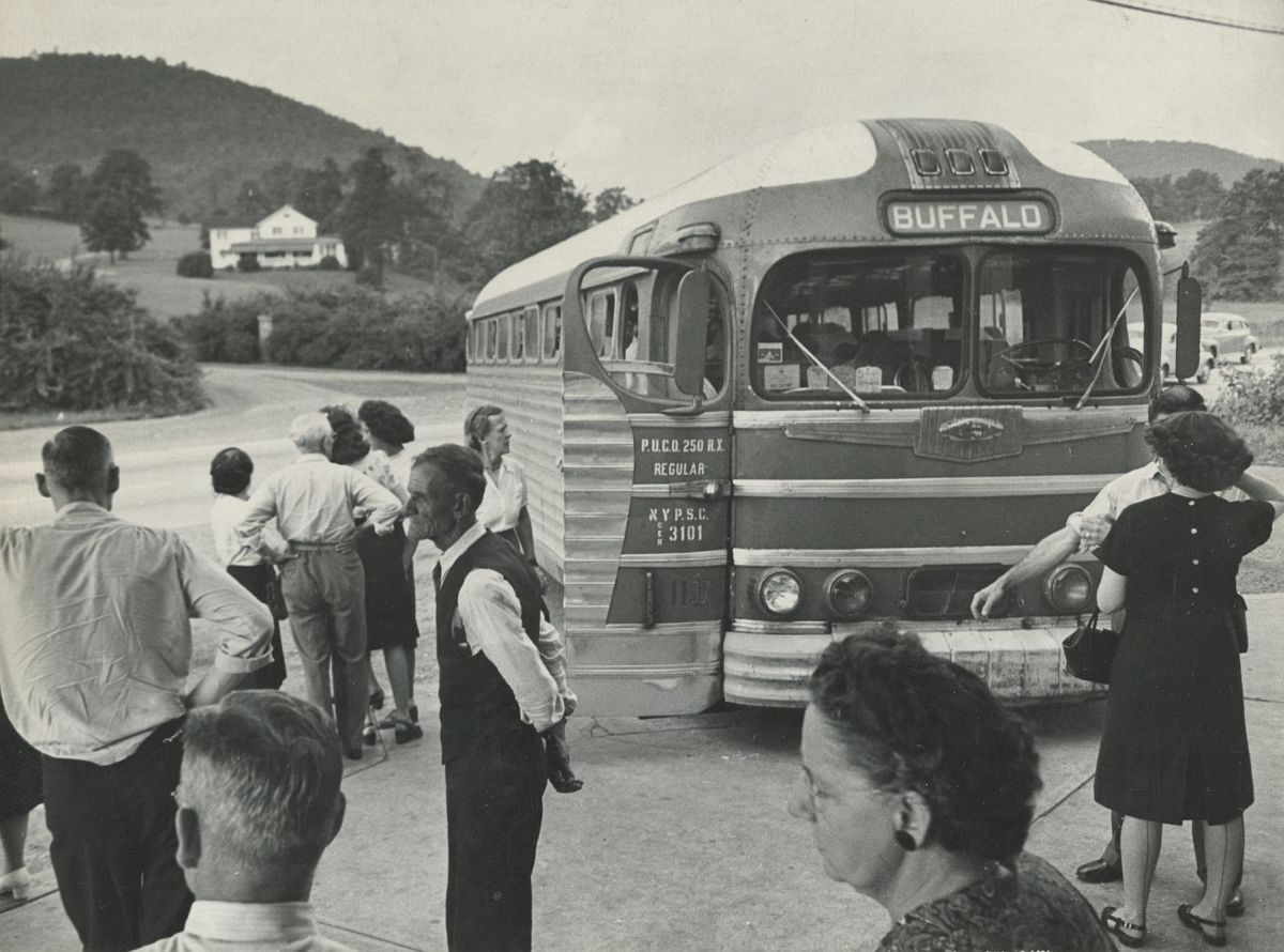 ESTHER BUBLEY Passengers from Buffalo-bound bus at rest stop near Bath, NY, 1947  Mounted. Photographer's credit stamp on mount verso, 1947    Gelatin silver print; printed c.1947