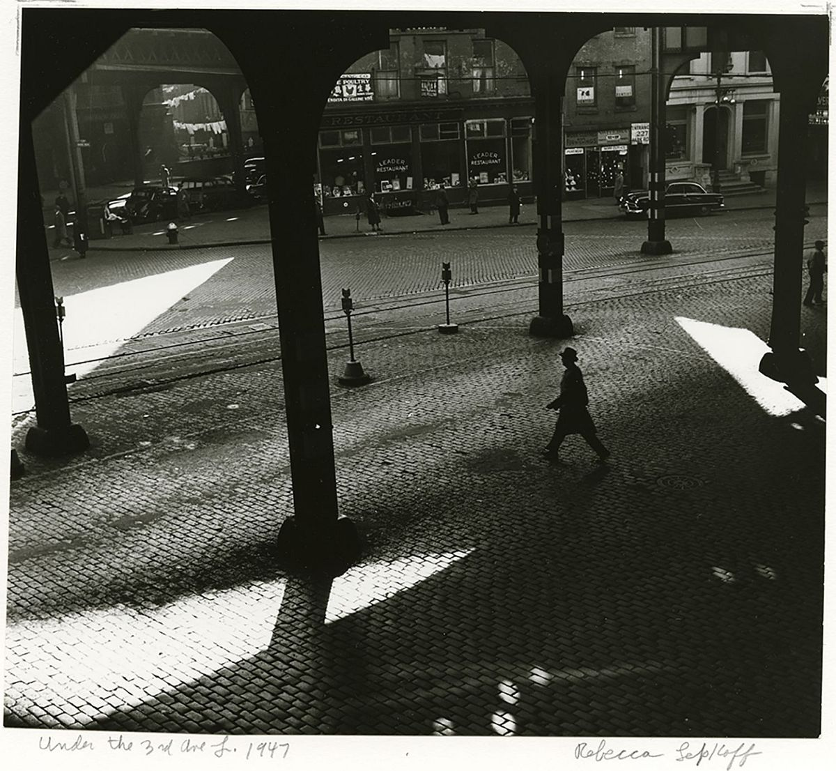 REBECCA LEPKOFF Under the 3rd Ave. El, 1947    Mounted. Signed, titled, dated, and annotated in pencil on verso, 1947    Gelatin silver print; printed later