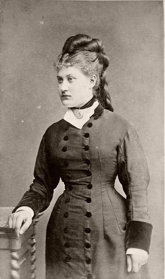 Woman standing circa 1884