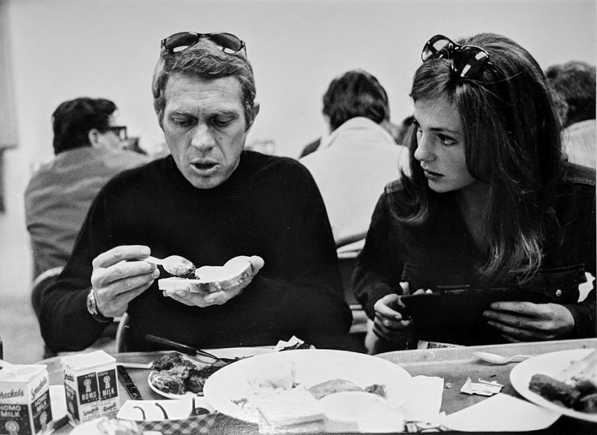 "Photograph by Hatami (1928-2017) Steve McQueen and Jacqueline Bissett conversing at lunch, on the set of ""Bullitt"" photograph 1968"