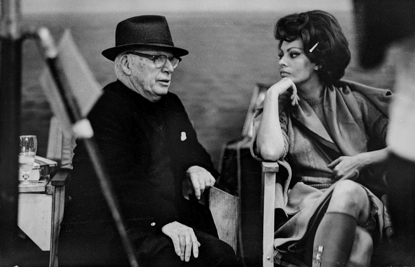 "Photograph by Hatami (1928-2017) Sophia Loren and Charlie Chapling on the set of ""A Countess from Hong Kong,"" Pinewood Studios, Buckinghamshire photograph 1966"