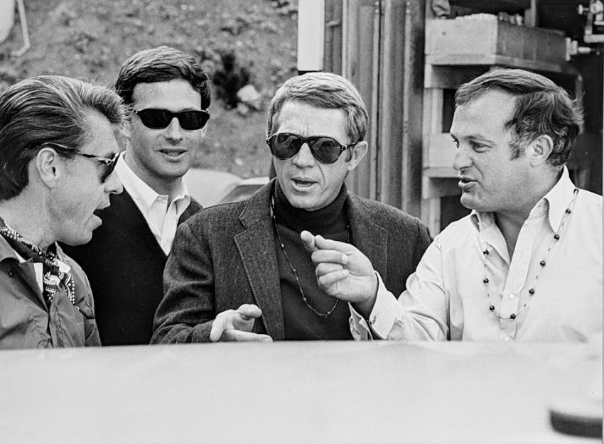 "Photograph by Hatami (1928-2017) Steve McQueen, Peter Yates and crew discussing the next scene, on the set of ""Bullitt"" photograph 1968"