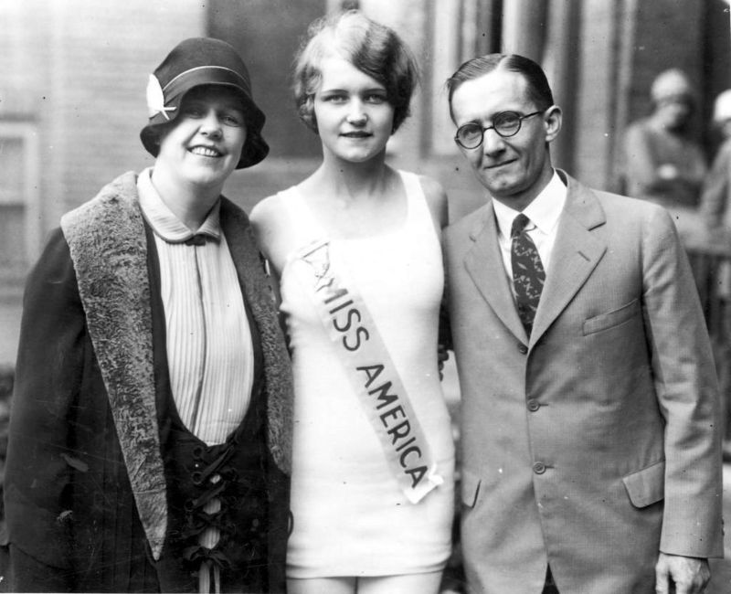 Miss America Lois Delander, a Joliet High School junior who was selected queen of beauty at the Atlantic City pageant, is seen with her parents, Mr. and Mrs. Albin Delander, 1927