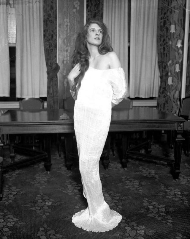 Mrs. Wallace Ford models a dress that she will wear to the Miss America costume for arts ball at the Stevens Hotel, Nov. 20, 1927