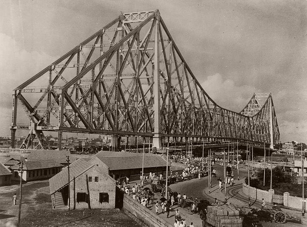 Calcutta boasts the third largest cantielver bridge in the world. Its real importance, however, lies in the fact that it serves as Calcutta's gateway to the wese, being the city's only bridge spanning the Hooghly.Taking 7 years to build, it cost $10,000,000. It towers 310 feet as the city's highes structure, is 2,150 feet long with a center span of 1,500 feet. It was completed in 1942, opened in February, 1943.