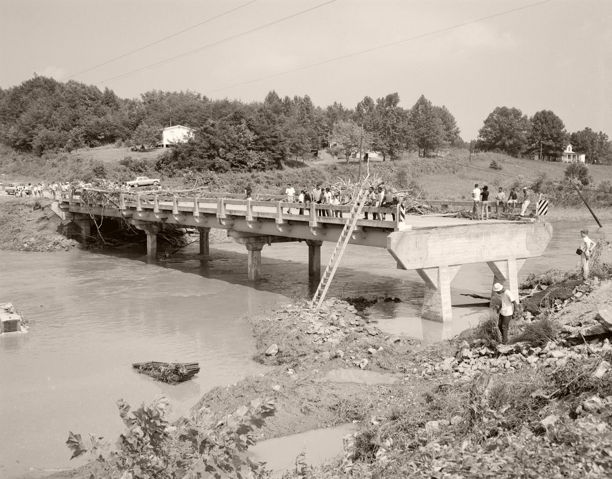 Onlookers gather on the badly damaged the Rt. 29 Buffalo River Bridge, approximately two miles north of the intersection with Rt. 60 in Amherst County. Photo taken looking north. No. 69-1173, Virginia Governor's Negative Collection, Library of Virginia.