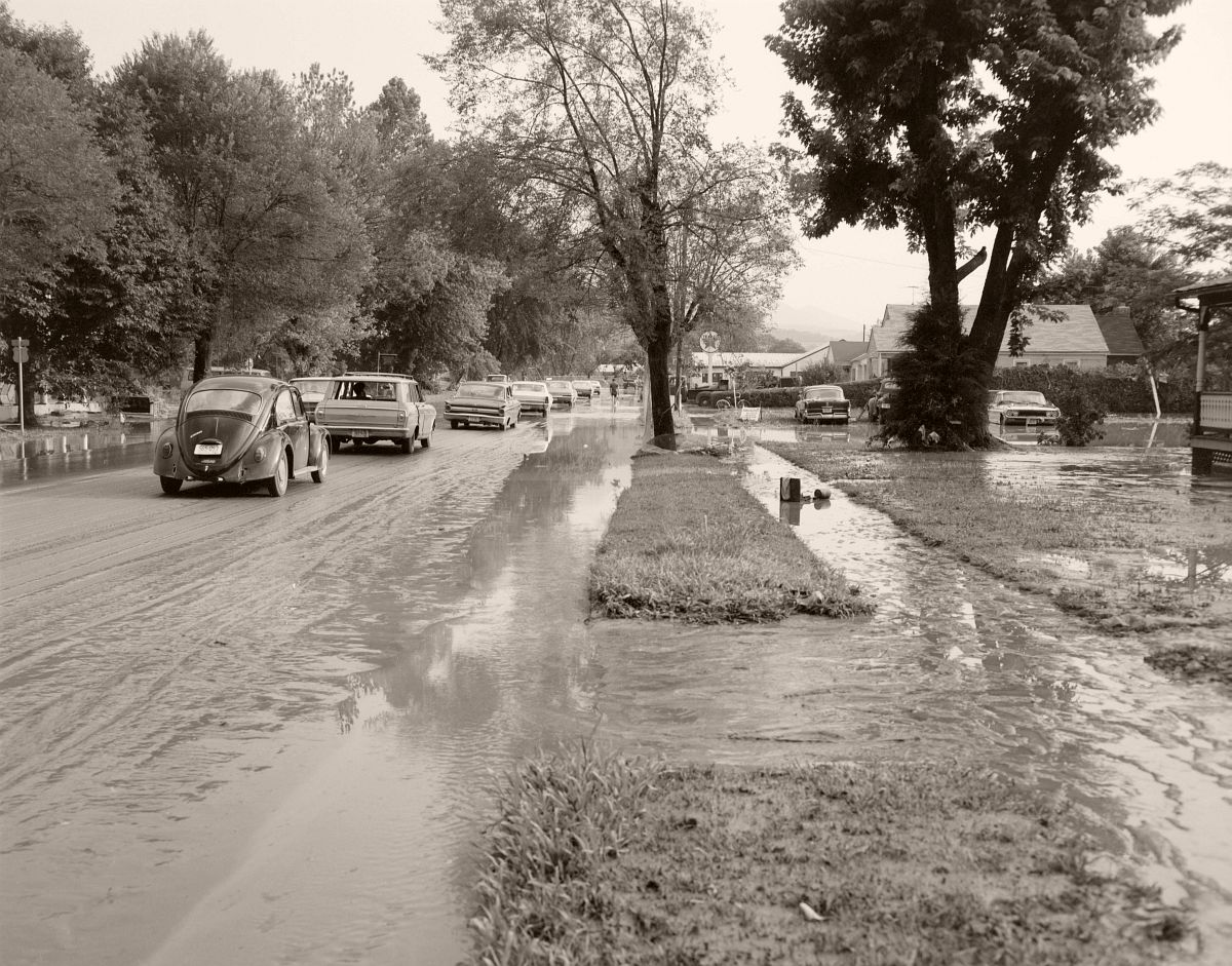 Though yards and driveways were still underwater, traffic was able to move both directions on Magnolia Avenue in Buena Vista, Virginia following Hurricane Camille. The small town in Rockbridge County recorded 5 feet of standing water in the downtown area. No. 69-1177, Virginia Governor's Negative Collection, Library of Virginia.