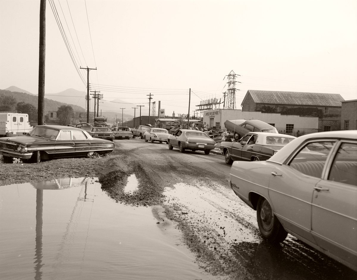 Sycamore Avenue in Buena Vista was passable at the time of this photograph, but some vehicles appear to have stranded during the flash flooding and not yet retrieved by their owners. Rescue Sqaud vehicle visible on left. Located just off Rt. 501 in Rockbridge County. No. 69-1178, Virginia Governor's Negative Collection, Library of Virginia.