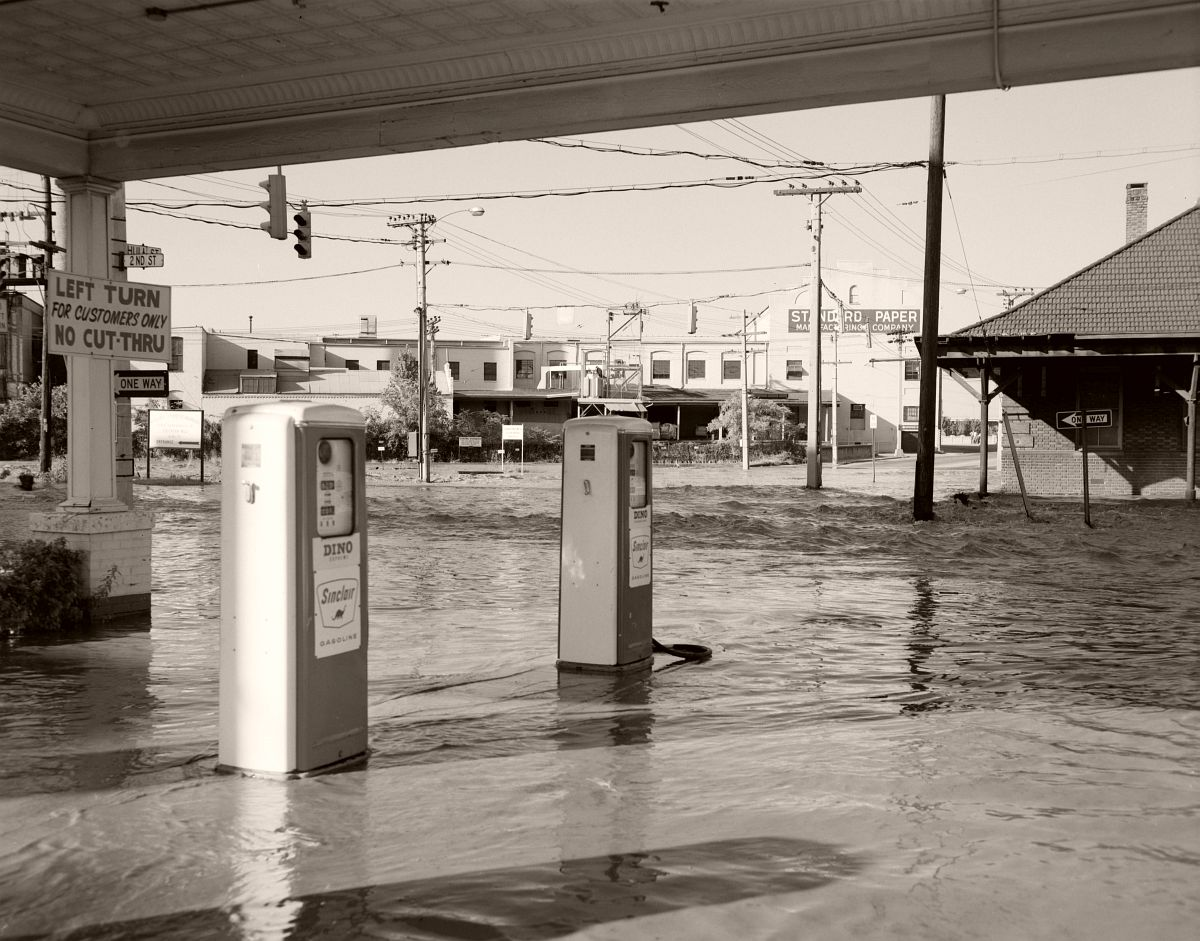 Businesses near the southern end of the 14th Street Bridge are completely flooded. Located at the intersection of Hull Street and 2nd Street. No. 69-2026, Virginia Governor's Negative Collection, Library of Virginia.