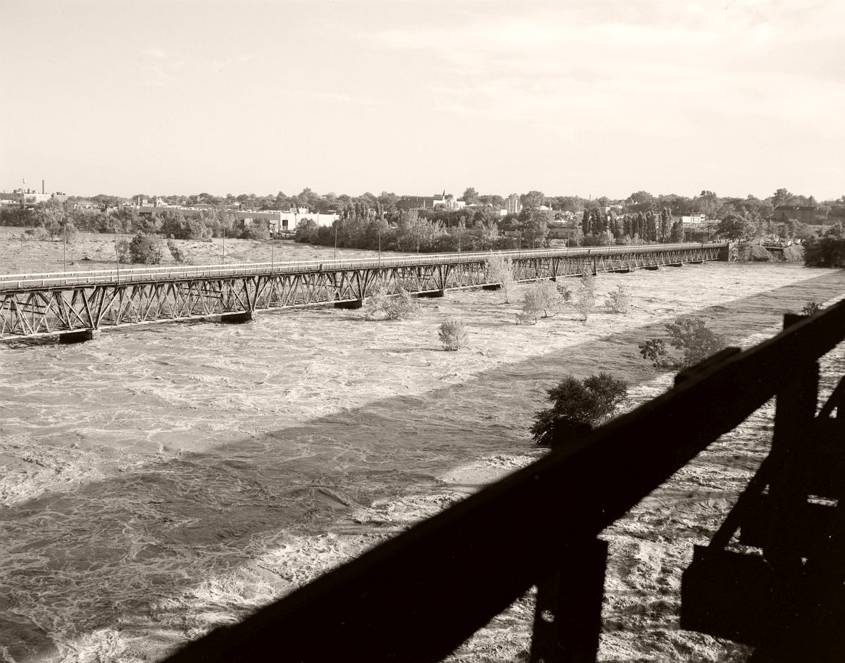 The waters of the James River nearly cover the piers of the 9th Strett Bridge in Richmond. No. 69-2033, Virginia Governor's Negative Collection, Library of Virginia.
