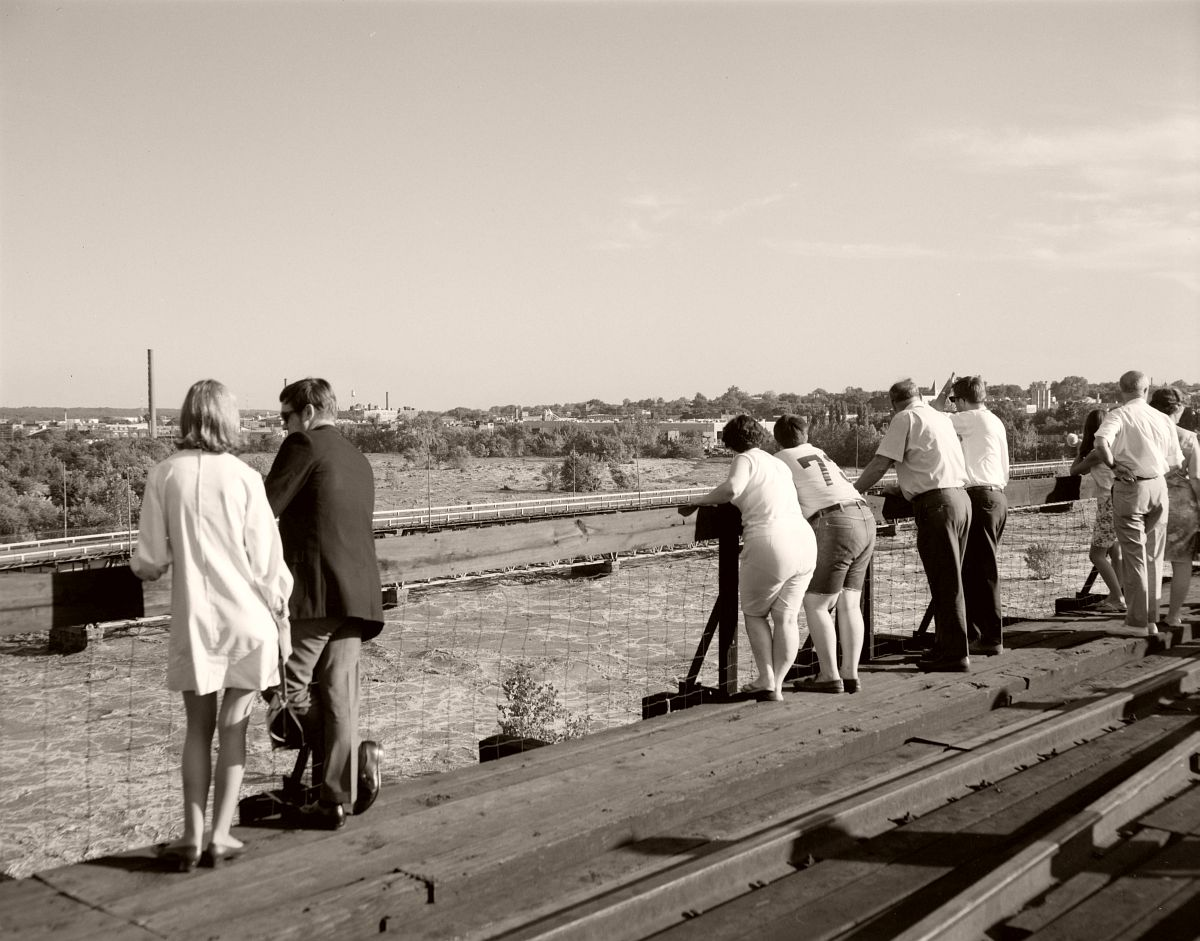 Locals gather on the 9th Street Bridge to look down on the flooded James River. No. 69-2046, Virginia Governor's Negative Collection, Library of Virginia.