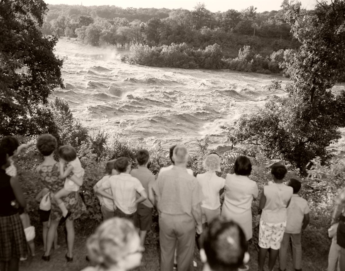 Onlookers gather to watch the flood waters of the James River near the south end of of the Lee Bridge in Richmond. The James River peaked at 28.6 ft in Richmond from Hurricane Camille. No. 69-2051, Virginia Governor's Negative Collection, Library of Virginia.
