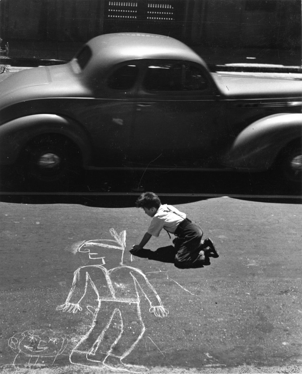 John Gutmann, The Artist Lives Dangerously, San Francisco, 1938; gelatin silver print; 14 x 11 in.; BAMPFA, promised gift of Victoria Belco and William Goodman in memory of Teresa Goodman. John Gutmann, © 1998 Center for Creative Photography, Arizona Board of Regents.