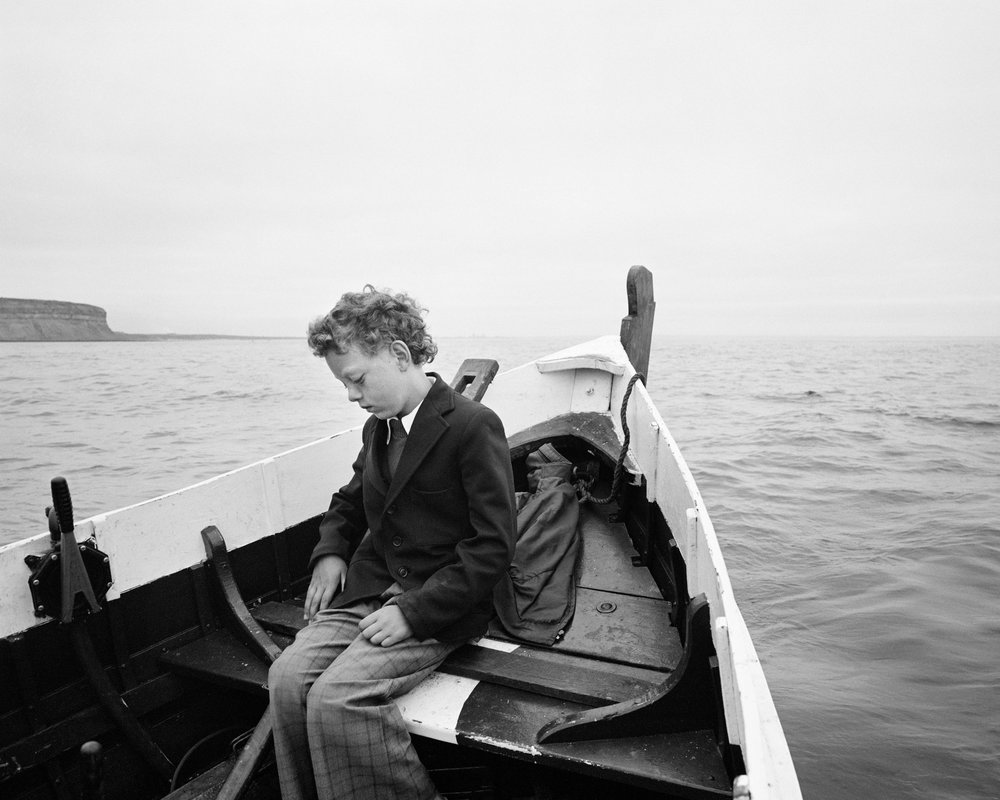 Simon Coultas being taken to sea for the first time since his father drowned  Gelatin silver print 20 x 24 inches 1984
