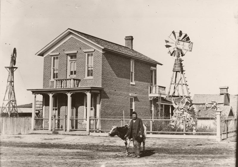 The Marquis Victor house on Plum Avenue in Sedalia, Colorado built before 1876 by John Craig. The house is two stories, brick, and has a pitched roof with a chimney in the back, 1890
