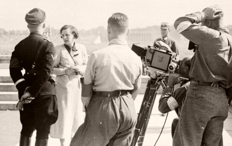 Riefenstahl stands near Heinrich Himmler while instructing her camera crew at Nuremberg, 1934