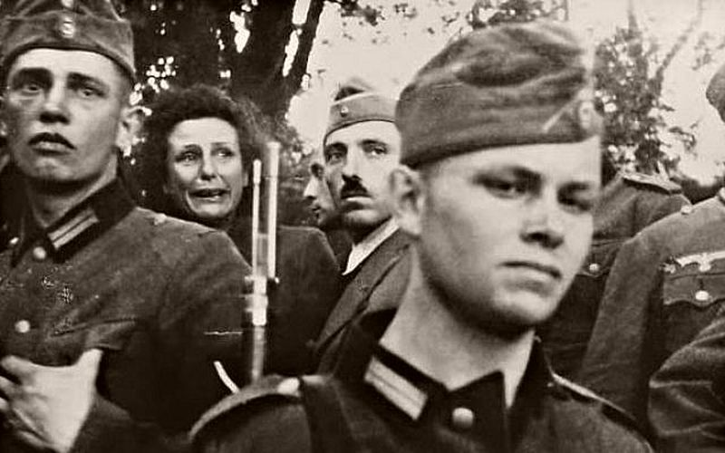 During the second week of World War II, German filmmaker Leni Riefenstahl (background) reacts to the execution of civilians in Konskie, Poland (public domain)