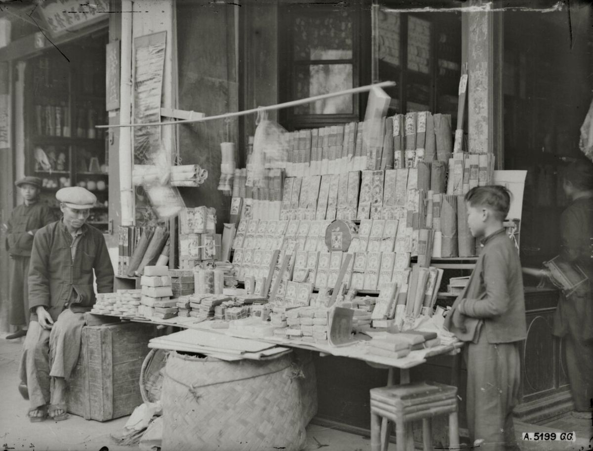 A Hanoi store sells firecrackers and sticks of incense for Tet in 1929. Firecrackers were burst during Tet to repel ghosts and demons, but they were banned by the Vietnamese government in 1995 because the production and explosions were causing too many accidents, deaths and injuries.