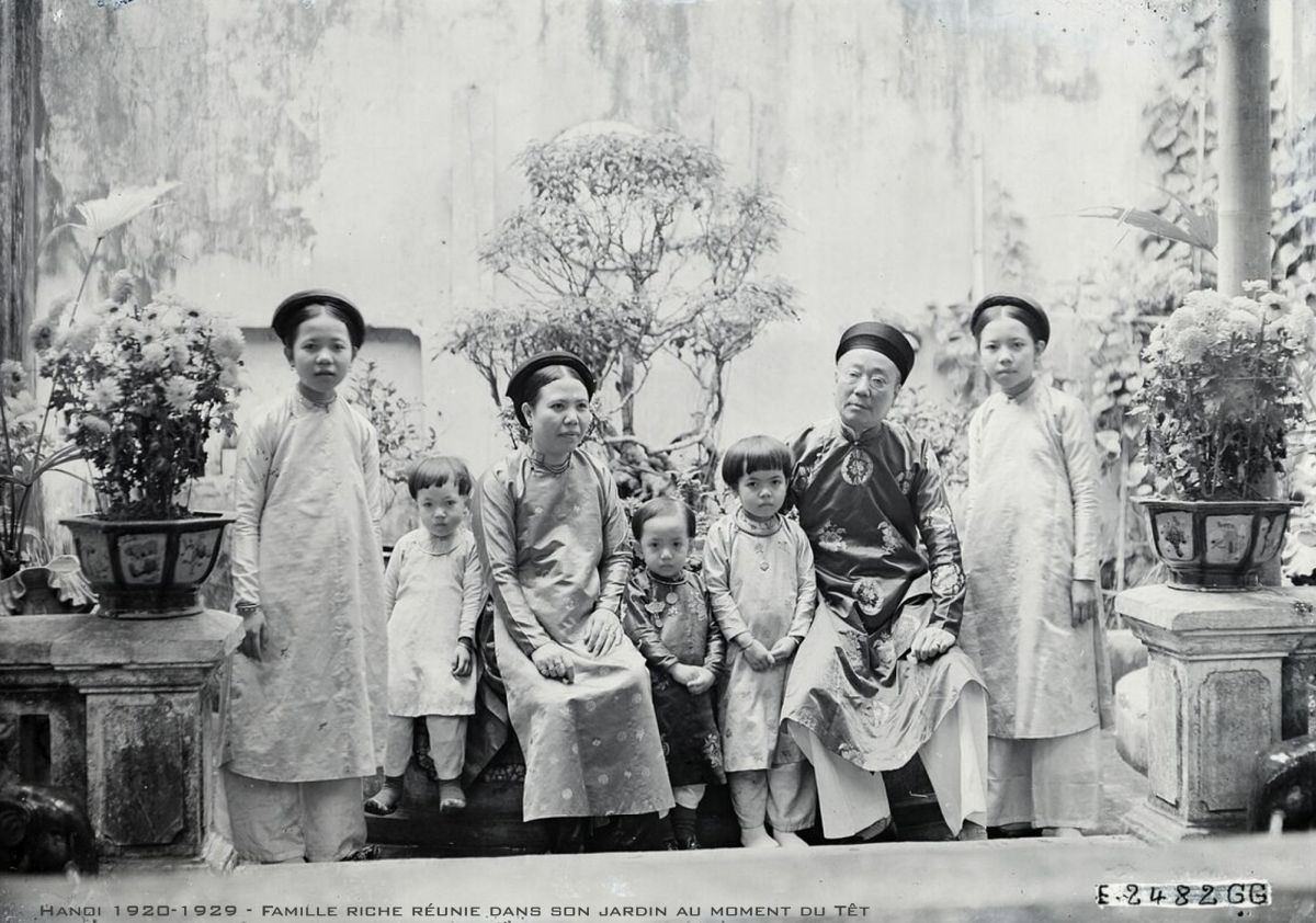 A Hanoi family poses for a picture as part of Tet celebrations.