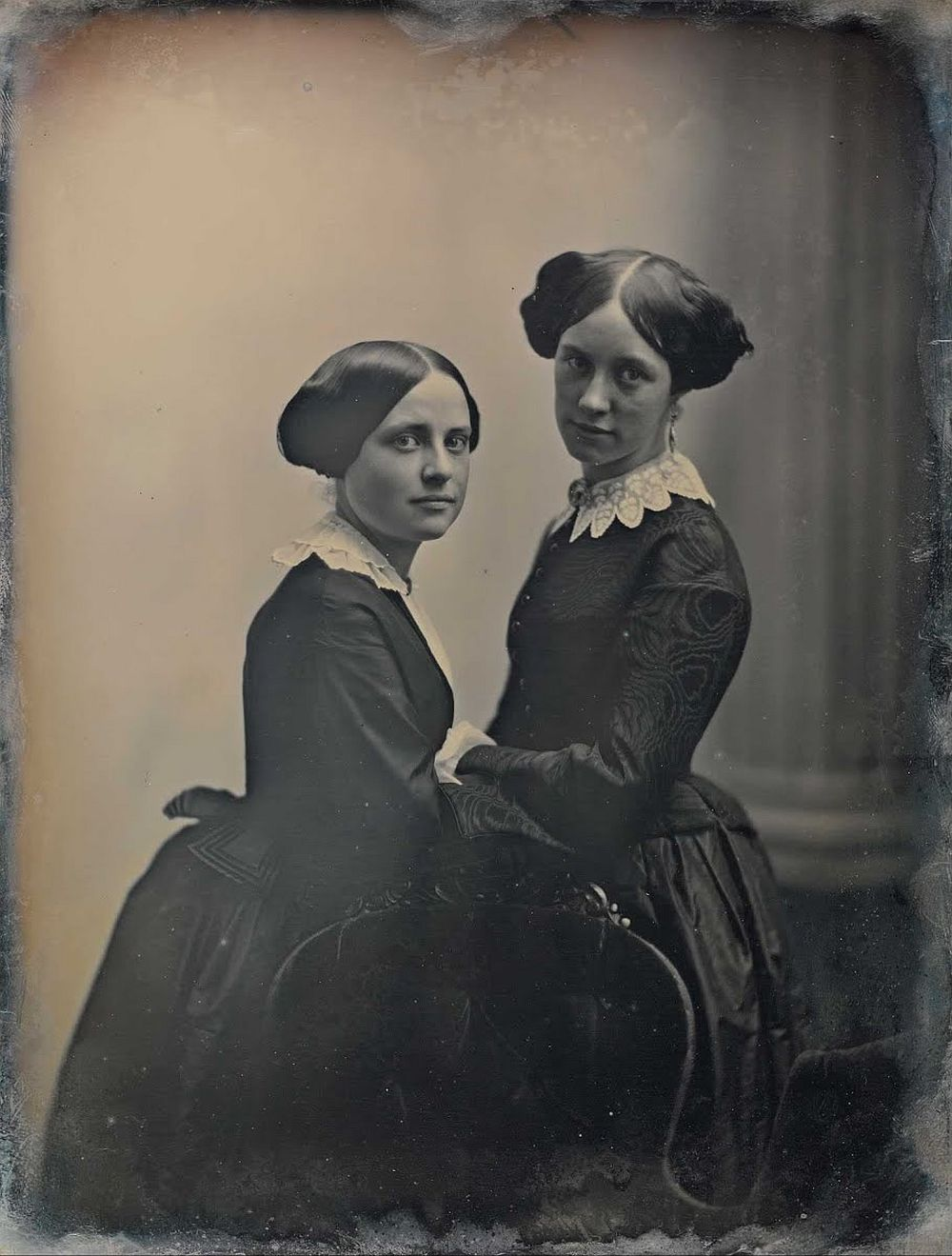 [Two women posed with a chair] Albert Southworthca. 1850
