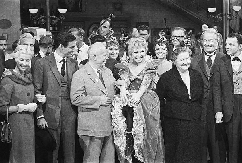 Alexander Ustinov Nikita Khrushchev's visit to the USA. In the foreground from right to left: Frank Sinatra, Maurice Chevalier, NinaKhrushcheva, Shirley MacLaine, Nikita Khrushchev, LouisJourdan. 19–20 September 1959