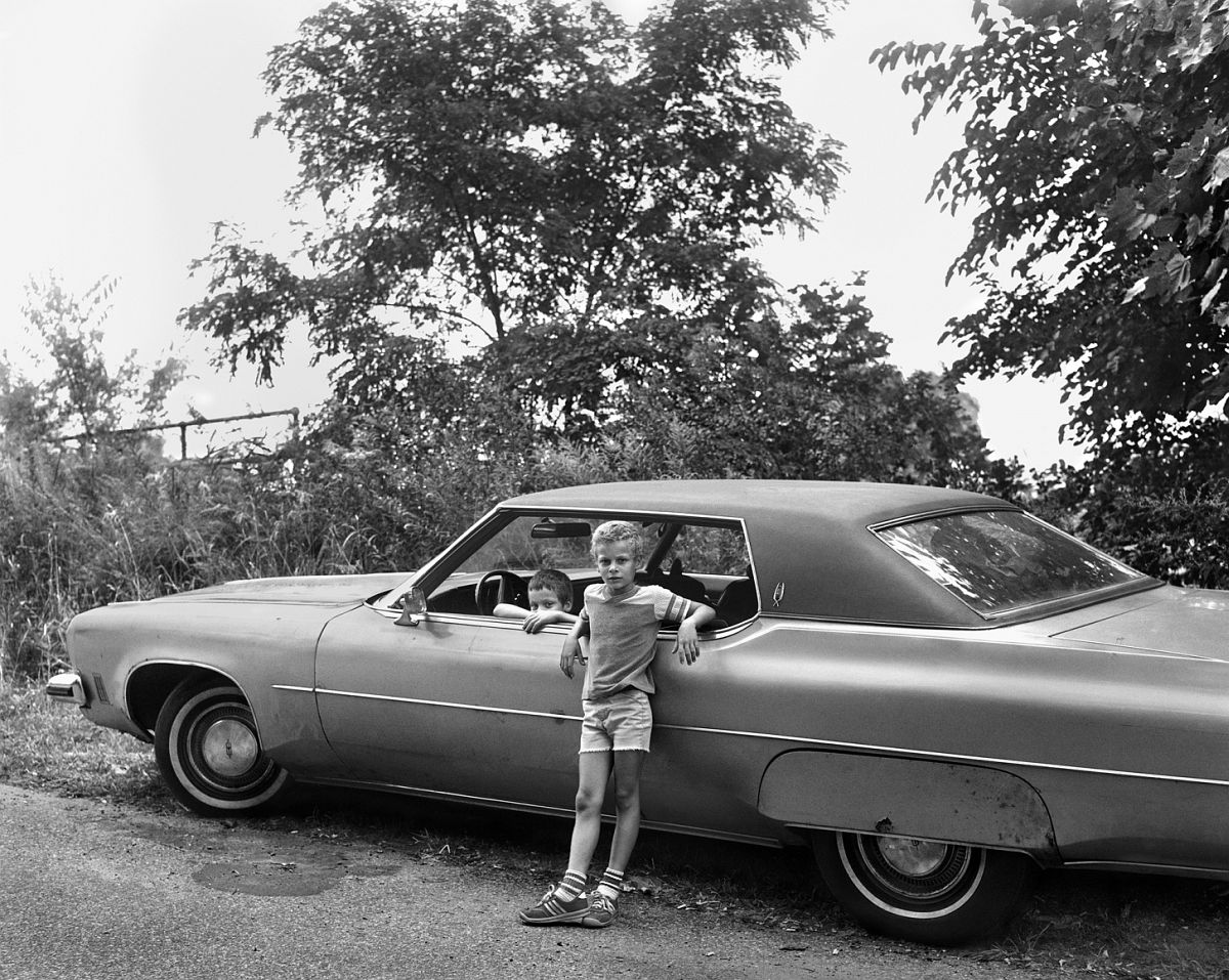 Two Boys with Automobile 1983-84 gelatin silver print 11 x 14 inches