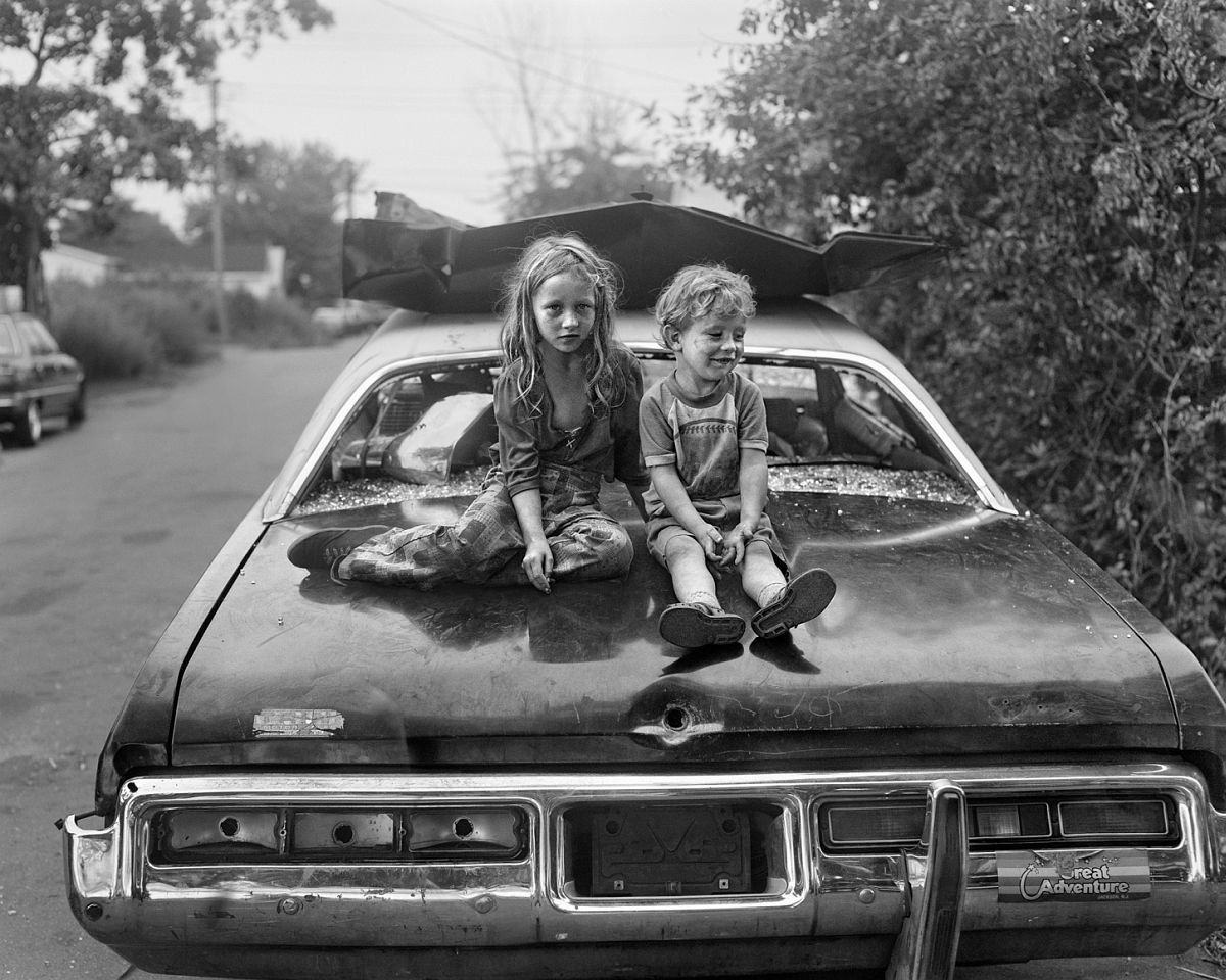 Children on Wrecked Car 1983-84 gelatin silver print 20 x 24 inches