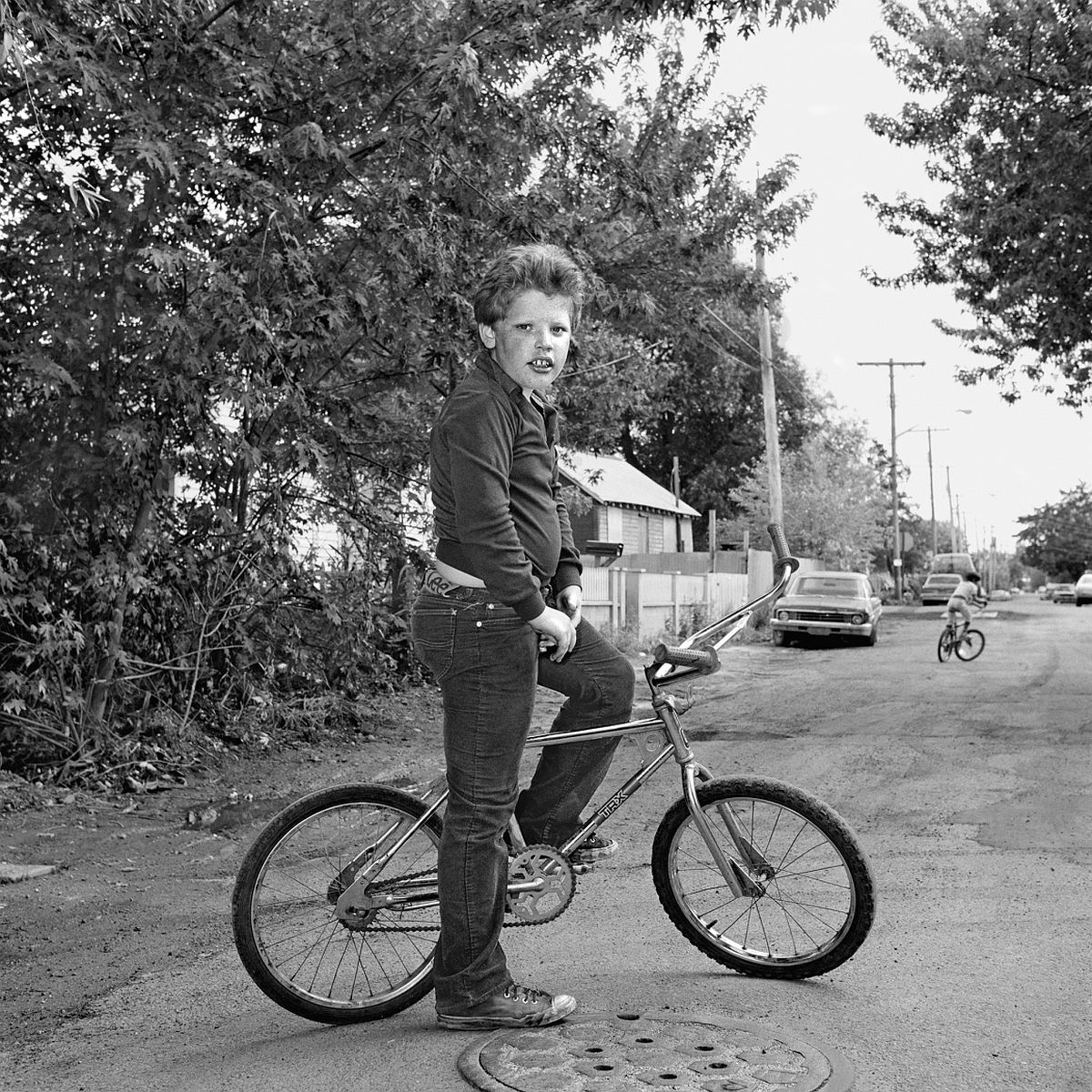 Boy on a Bike 1983-84 gelatin silver print 14 x 11 inches