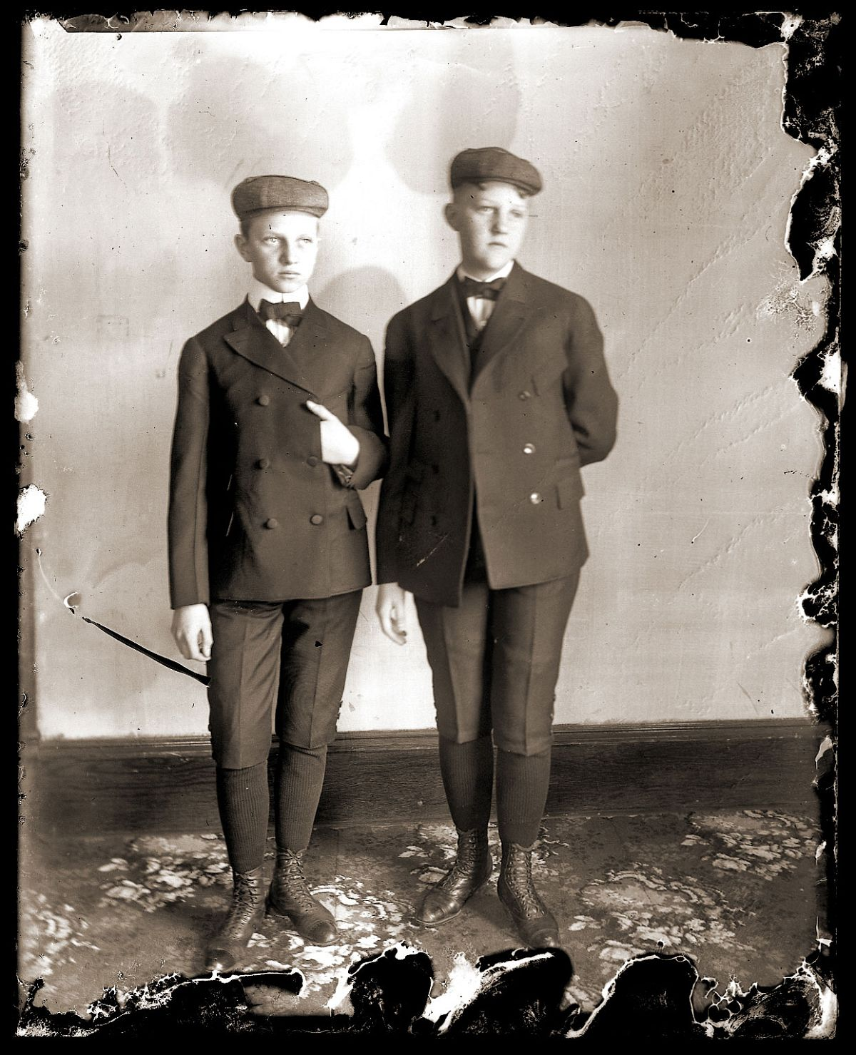 Two young boys in suits