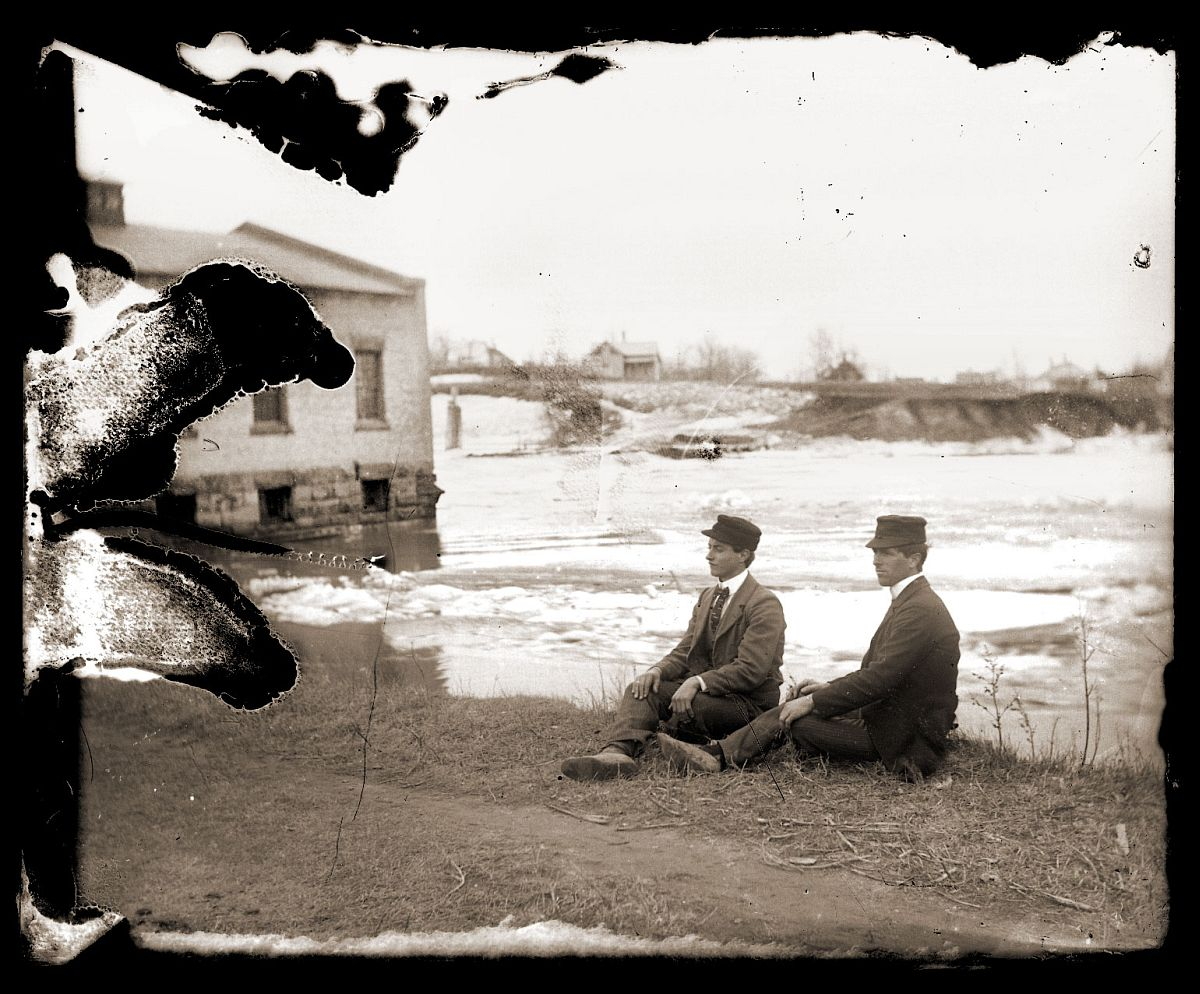 Men sitting on a shore