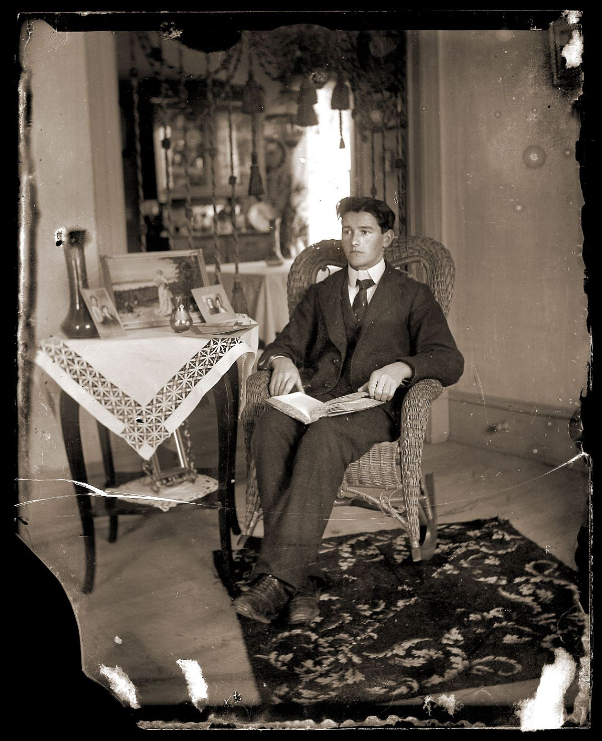 Young man in a wicker chair, c1913