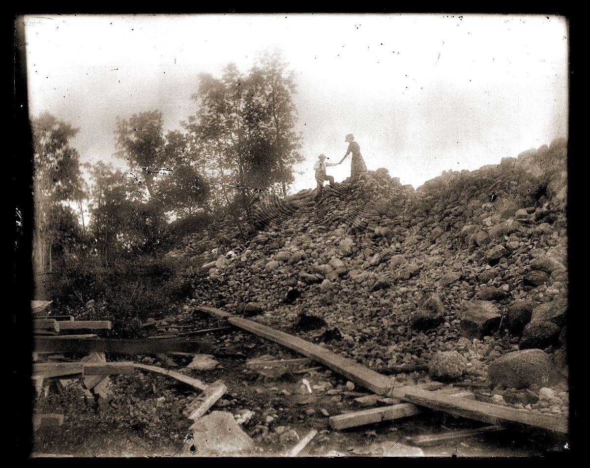 Couple on rubble pile, c1913