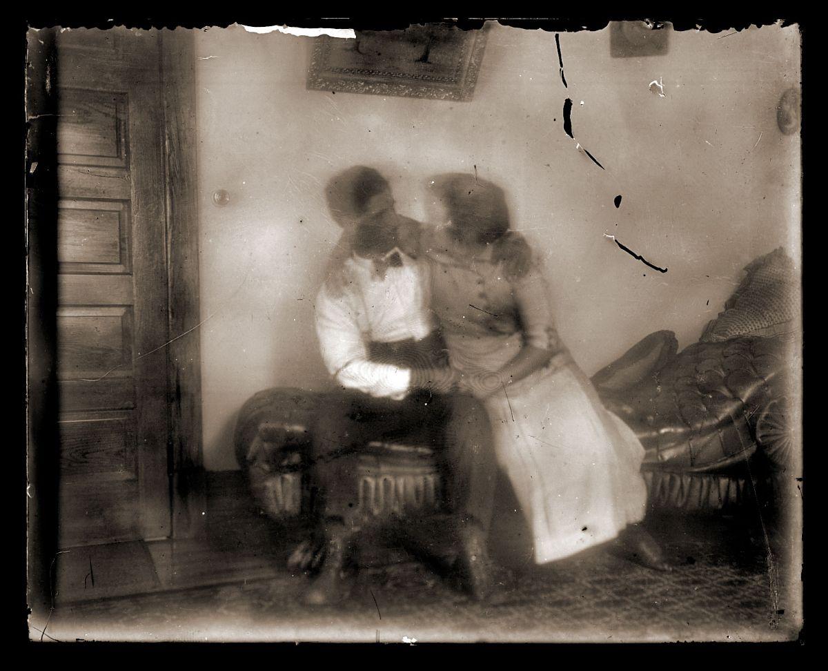 Couple on loveseat, c1913